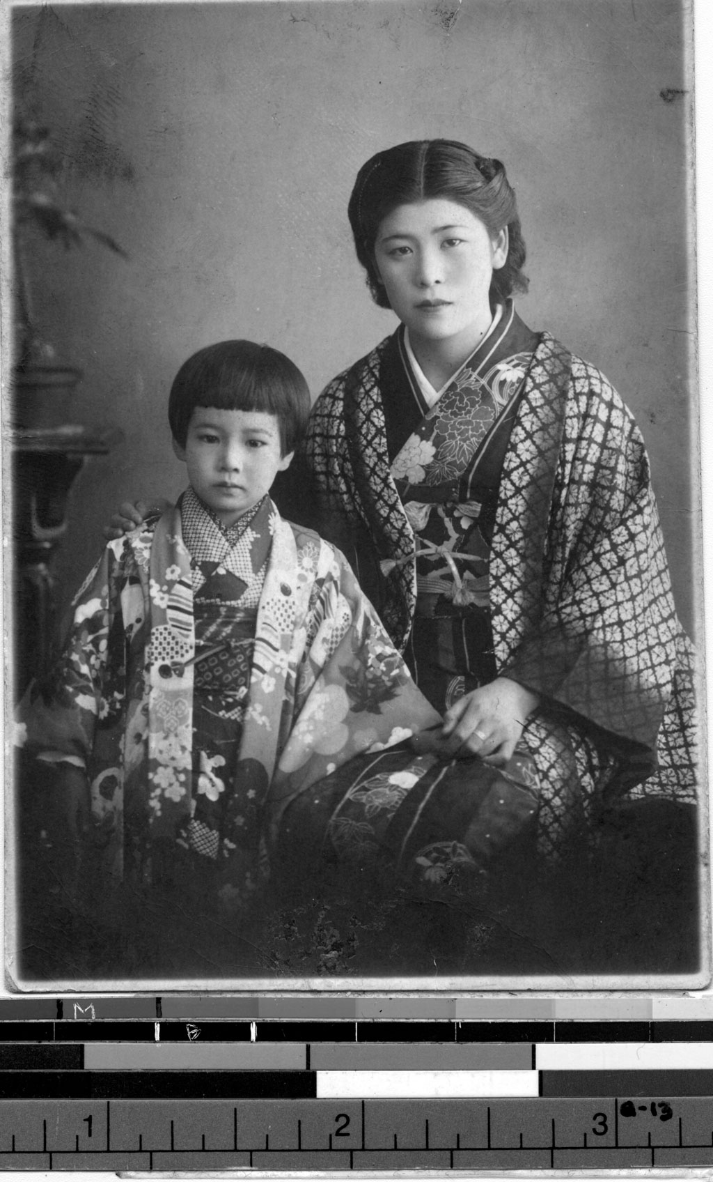 A professional portrait of a Japanese American woman and her child | Image Courtesy of the USC Digital Archives.