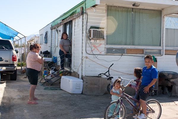 Family in Duraville.  Photo by Maria Zepeda