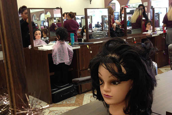 More than working with mannequins, students at The Professional Institute of Beauty learn to work with real people from all walks of life. Photo by Irene Hsu.