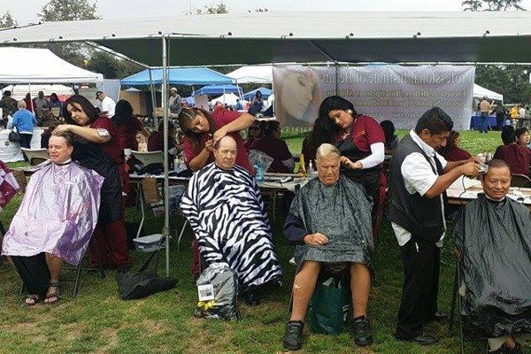 PIB students give war veterans free haircuts at one of many community events they participate in. Photo courtesy of Professional Institute of Beauty.