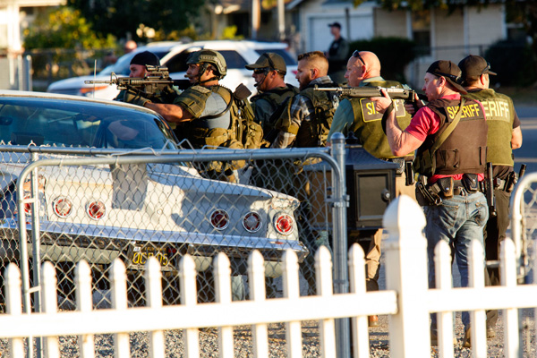 Law enforcement officers search for the suspects of a mass shooting December 2, 2015 in San Bernardino, California. Photo by Patrick T. Fallon/AFP/Getty Images
