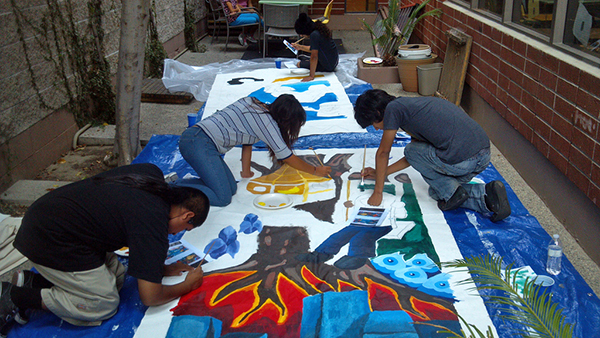 Youth paint a mural at L.A. Commons