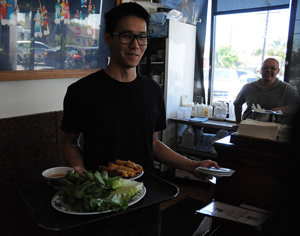 Waiters are always ready to make tasty recommendations to Vietnamese cuisine newbies. Photo by Alejandro Bryan Rosas.