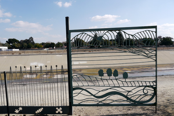 Decorative gates lead park visitors directly to the San Gabriel River and its bike paths | Photo: Yosuke Kitazawa.