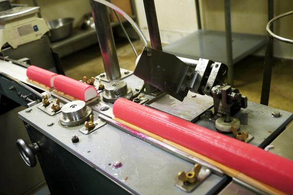 A machine slices kamaboko to its proper length at the Yamasa Enterprises facility near Little Tokyo | Photo by Yosuke Kitazawa