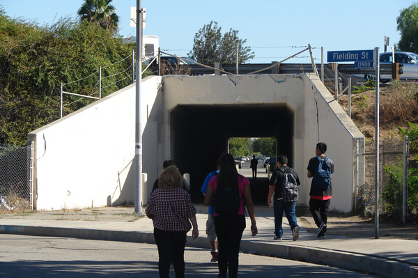 San Fernando High School students walk through a pedestrian tunnel under the 118 Freeway. Pacoima is ringed on three sides by elevated freeways creating unpleasant barriers for pedestrians and cyclists.