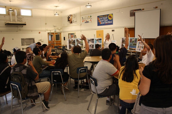 Jan Dyer from MLA Architects engages students in a focus group to gain input on an improvement to a pedestrian bridge over the Pacoima Wash.