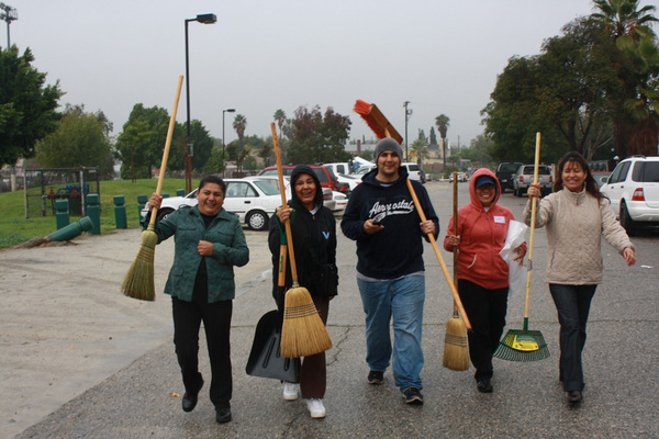Residents participate in a rainy cleanup around the Pacoima Wash. The Wash is a popular site for illegal dumping. Hosting cleanups was a good way to keep residents engaged in the Pacoima Wash project.