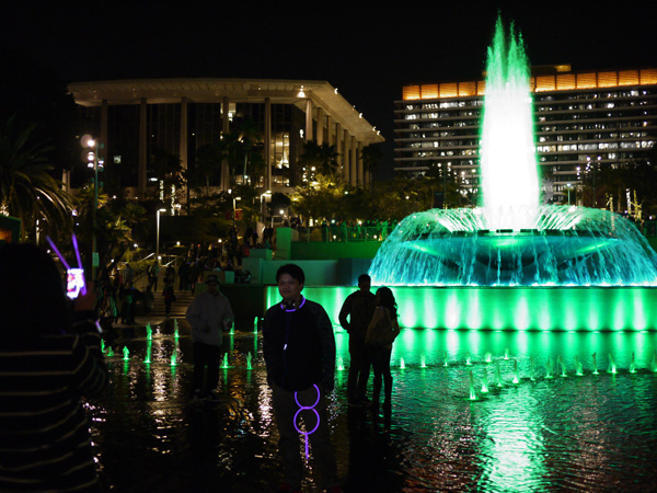 The lighted up fountain is a popular spot to take pictures by