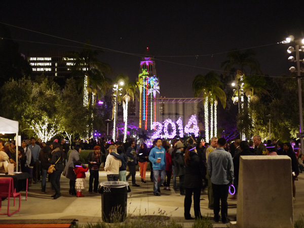 A 2014 light sculpture and projected palm trees on City Hall in the background