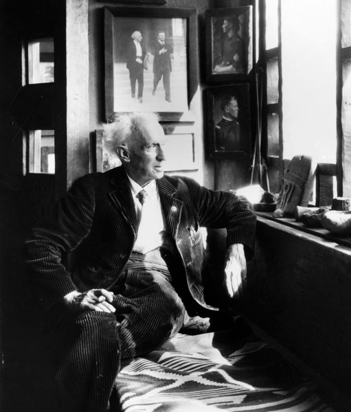 Charles Lummis seated in his study at 'El Alisal' in Highland Park; behind him is a photograph of Lummis with Theodore Roosevelt | Photo: Security Pacific National Bank Collection/LAPL
