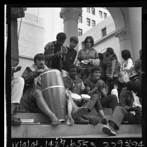 Group of ''Venice bohemians'' playing bongos on steps of Los Angeles City Hall to protest city ordinance, 1965 | Los Angeles Times photographic archive/UCLA Library/Creative Commons