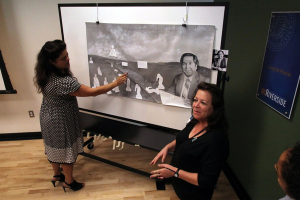 Sandy Rodriguez and Barbara Carrasco leading a mural workshop at UCR