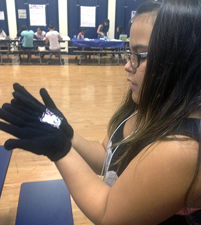 Eileen shows off her gloves that light up when put together