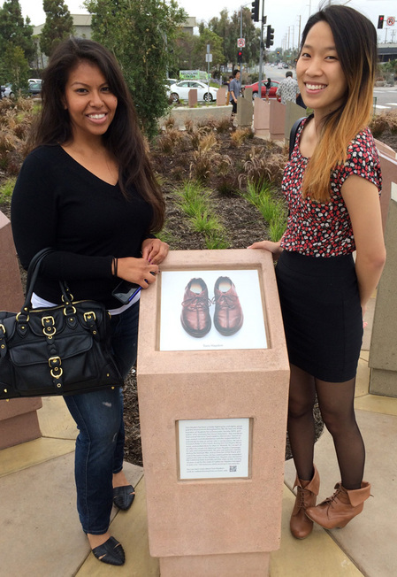 The City Project's Dayana Molina and Michelle Kao at the pedestal with Tom Hayden's shoes