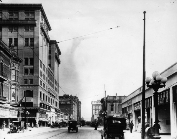 The intersection of Olive and 7th Streets, looking south on Olive. L.A.A.C. building is on the right, ca. 1920s | Photo: Security Pacific Bank National Collection, Los Angeles Public Library