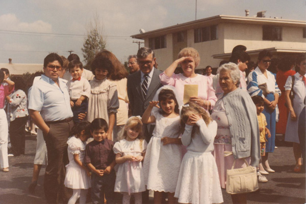 First Holy Communion, 1988. My aunt and uncle and their 3 kids are on the left, my sisters are by me, my grandparents are behind me, and to the far right is my great grandmother | Courtesy of Toni Plummer