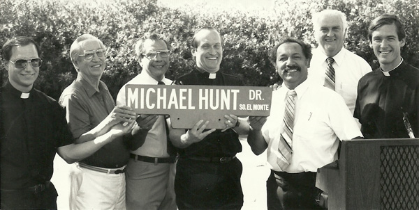Father Joe with Michael Hunt Drive street sign | Courtesy of South El Monte Arts Posse/South El Monte City Hall