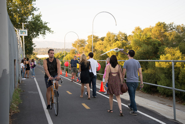Bicyclists, pedestrians, and public space gatherers use the greenway river trail multimodally | Photo: George Villanueva