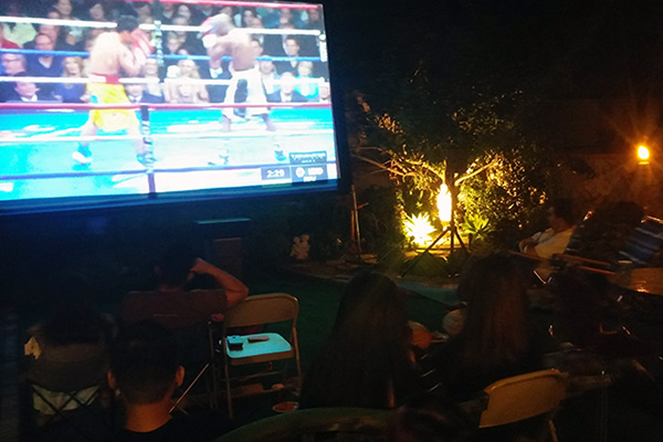 Across Southern California, Filipinos staged fight night parties, such as this one in the backyard of the Sayo residence in Sun Valley. | Photo: Elson Trinidad