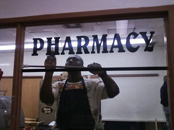 Working on Pharmacy sign