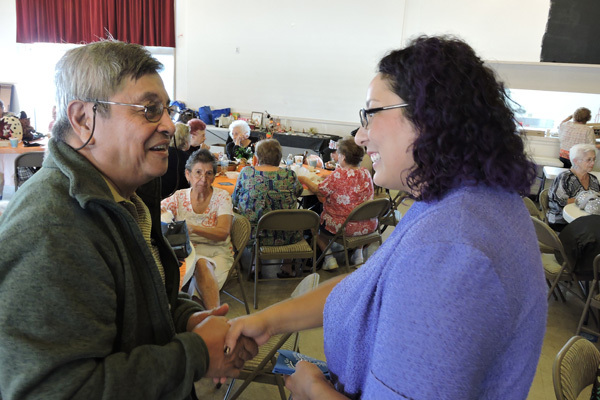Assemblymember Garcia greeting constituents at a senior center in 2012 | Photo: C. Garcia staff member