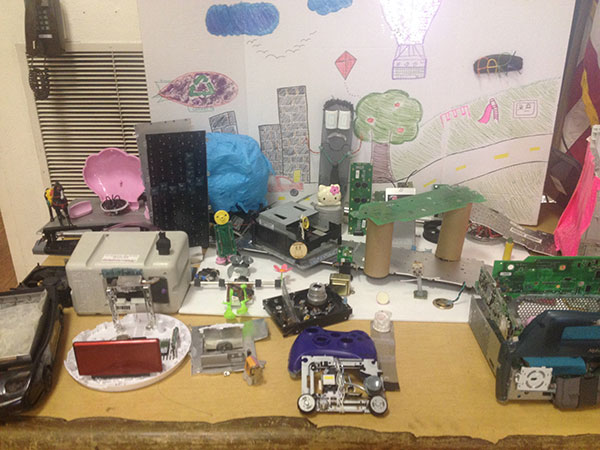 At a previous week of camp the girls created DIY City out of recycled electronics.