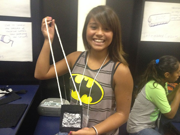 Dolly Baltazar shows off her purse.