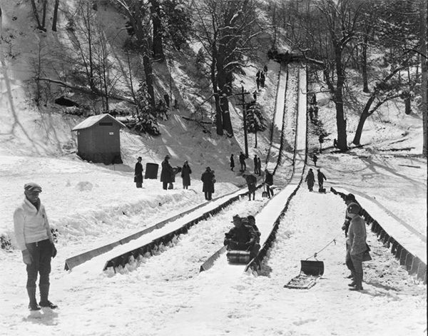 Several people hitting the tobogganing slopes at Big Pines | Digitally reproduced by the USC Digital Library; From the California Historical Society Collection at the University of Southern California