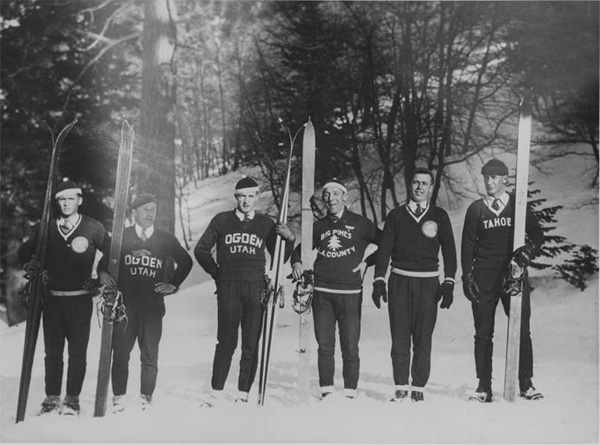 Six male skiers posing in a line, ca.1930 | Digitally reproduced by the USC Digital Library; From the California Historical Society Collection at the University of Southern California