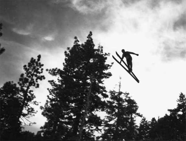 Ski jumping at Big Pines Recreation Camp, viewed from beneath the skier, 1929 | Digitally reproduced by the USC Digital Library; From the California Historical Society Collection at the University of Southern California