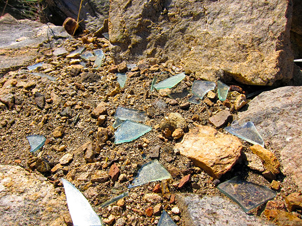 Shards of glass from the Lookout Mountain station are scattered over parts of the summit. | Photo: Daniel Medina