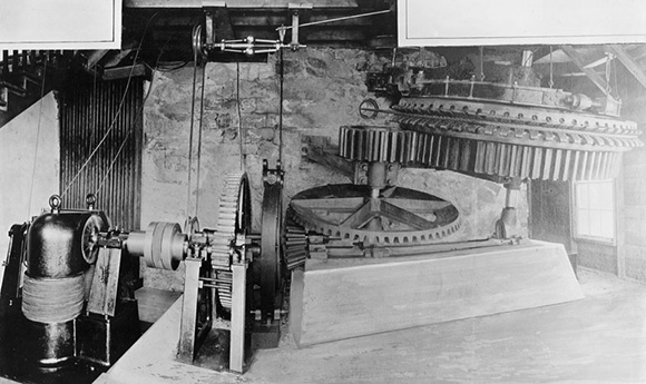 Shown here is a grip wheel, 9 feet in diameter, and other parts of the machinery called winding machinery located at the Echo Mountain station. | Courtesy of the Los Angeles Public Library