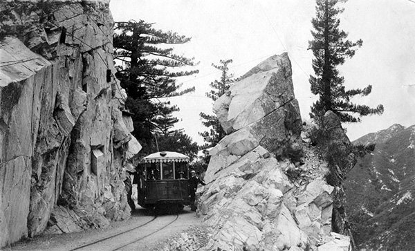 A Pacific Electric Railway car travels through the San Gabriel Mountains on one of the sections leading to and from Mount Lowe. | Courtesy of the Los Angeles Public Library