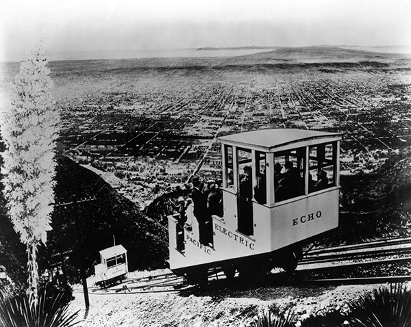 "The Incline rail car ""Echo"" and another car named ""Alpine"" are both approaching the widened portion of the Incline Rail where they can pass, one ascending and the other descending. 