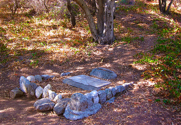 The triple headstones of the Rankin Children in Monrovia Canyon Parks. The headstones originally stood upright but were placed flat at a later time. | Photo: Daniel Medina