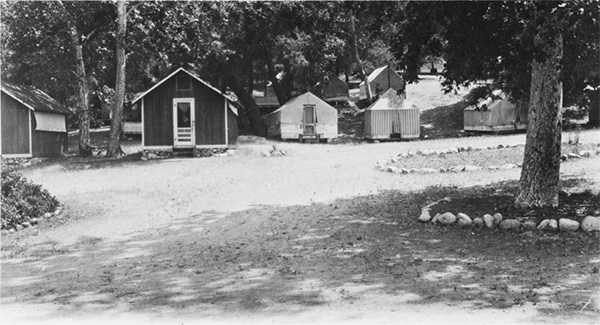 A frontal view of cabins at Camp Rincon, Azusa, ca.1930 | Digitally reproduced by the USC Digital Library; From the California Historical Society Collection at the University of Southern California