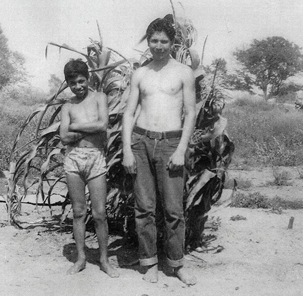 Youth posing on the shore of the Rio Hondo River | Photo: La Historia Historical Society Museum