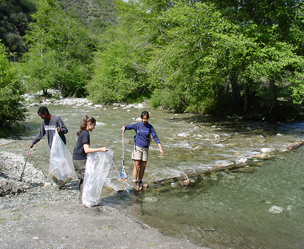 These teenagers are picking up debris from the East Fork of the San Gabriel River. Organized as a Scout project by Kayla Chang, then 15, the group gathered 17 bags of trash during one morning's work. | Photo: Farley Olander