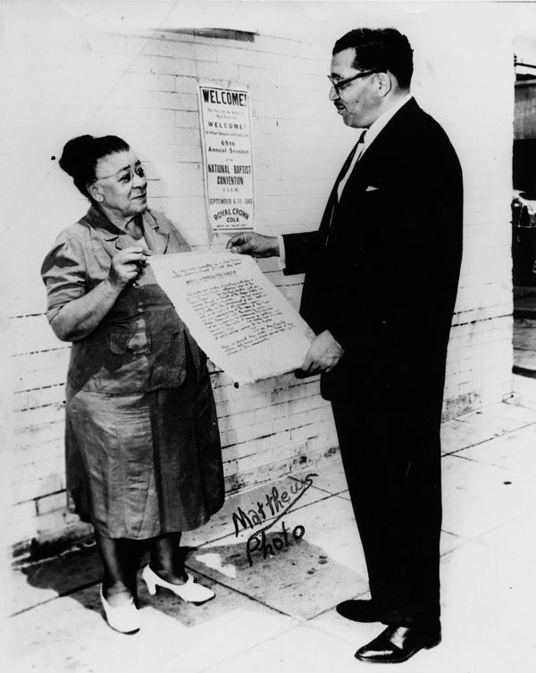 Charlotta Bass, publisher & editor of the first Black newspaper in Los Angeles, The Eagle, recieves declaration. ca. 1949