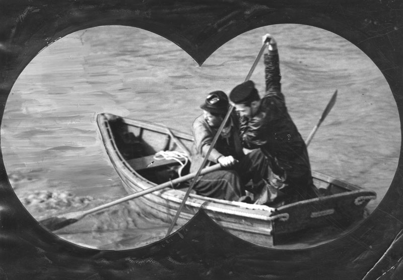 Two adventurers are shown as they appeared through binoculars from shore, sailing on the muddy Los Angeles River, ca 1938. Courtesy of LAPL.