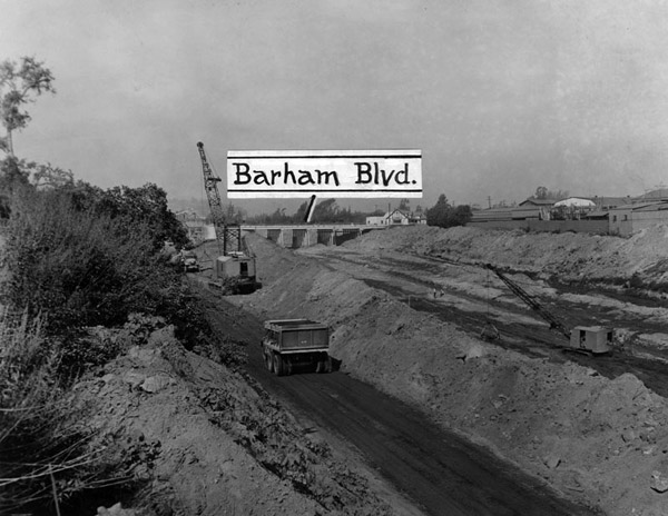 Cranes and trucks cementing of the river bed from Lankershim Boulevard to Niagara Street, 1947. Courtesy of the Los Angeles Public Library.