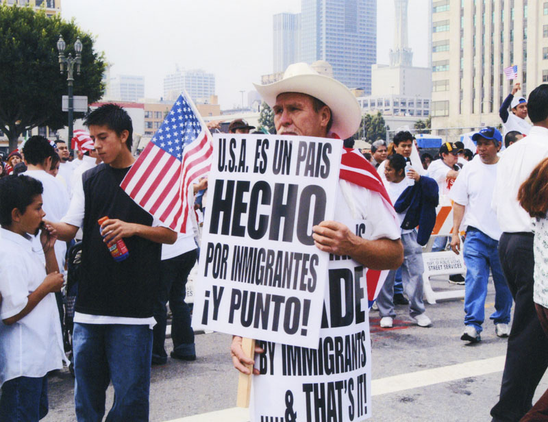 "Day Without an Immigrant protester holds signs in English & Spanish that read: ""U.S.A. is MADE by immigrants... & that's it!"" Photo is courtesy of the LAPL."