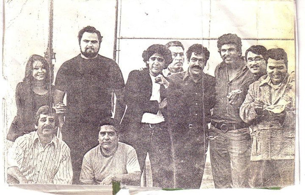 Manuel Cruz with Corky Gonzalez, Ramses Noriega and Rudy Salas, with Chicano Moratorium organizers at a fundraising art show in Boyle Heights in the summer of 1970. Image courtesy of Rosalio Munoz.