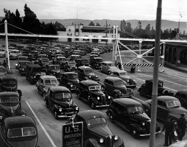 Cars returning to the U.S. from Mexico in 1941. The drivers and their passengers had apparently been attending the horse races at Agua Caliente. Photo from the Herald-Examiner Collection and courtesy the Los Angeles Public Library