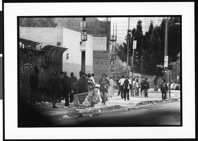 Homeless persons gathering on the sidewalk, Skid Row, Los Angeles, 1996. Photo by Jerry Berndt. Photo courtesy USC Digital Archives