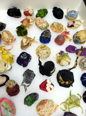 Sampling of Olive's miniature dolls hats, each one different. Percival collection, Ella Strong Denison Library, Scripps College