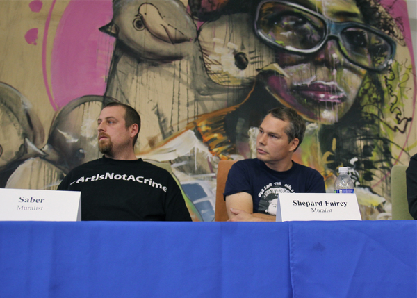Saber and Shepard Fairey listening to muralists in the audience during a January Mural Ordinance public meeting I Photo Ed Fuentes