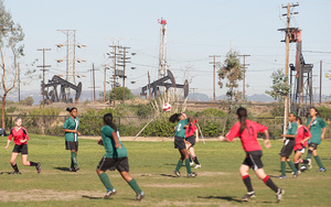 Youth soccer in the Baldwin Hills alongside active oil fields