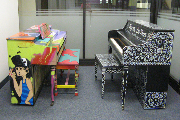 Pianos by ManOne and Stuart Vaughn at LACO offices waiting to be delivered I Courtesy of LACO